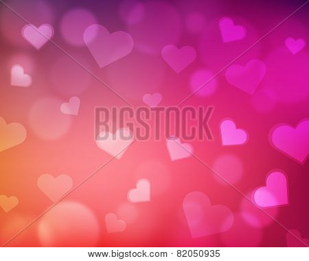 Blur background with love theme - hearts and light orbs - pink