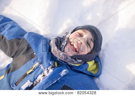 Child Boy Having Fun In The Canadian Winter