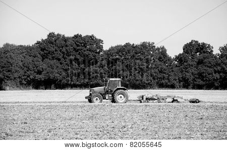 Tractor And Harrow Cultivating The Soil