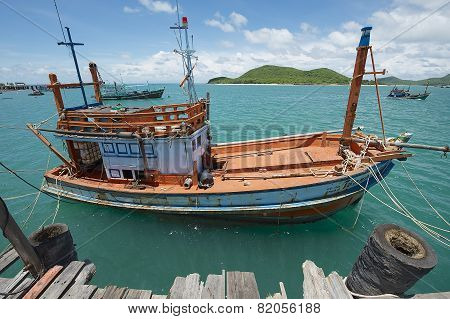 Old fishing boat tied at the harbor in Pattaya, Thailand.