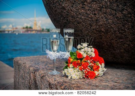 A Glass Of Champagne And A Bouquet Of The Bride On A Background Of The Peter And Paul Fortress