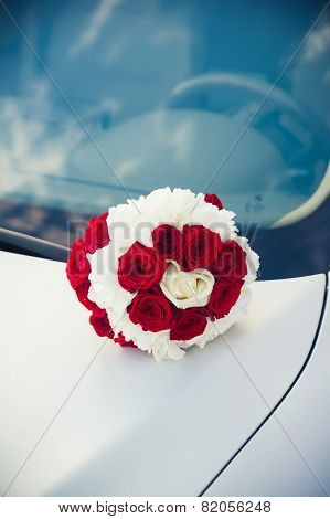 Bridal Bouquet  Lying On The Hood Of A Car