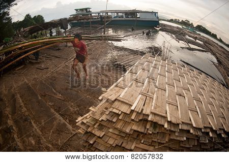 Workers Ashore Carrying Bamboo.