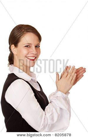 Attractive laughing businesswoman claps with hands.