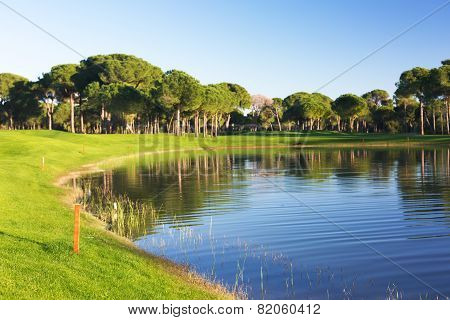 View Of A Pond At A Golf Course