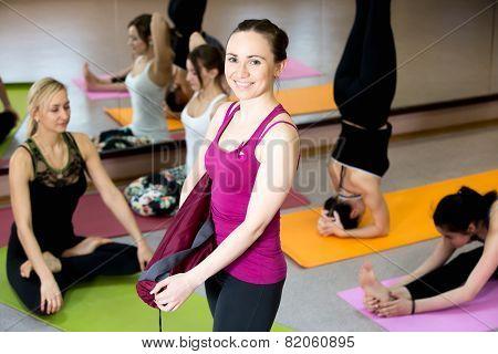 Smiling Yogi Girl Holding Folded Yoga Mat