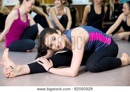 Yogi Girl Exercising In Class