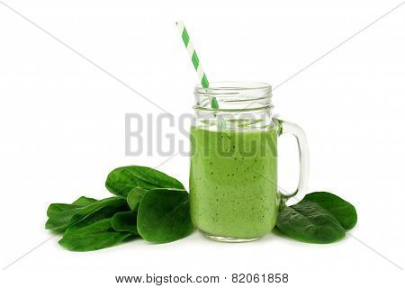 Green smoothie with spinach isolated