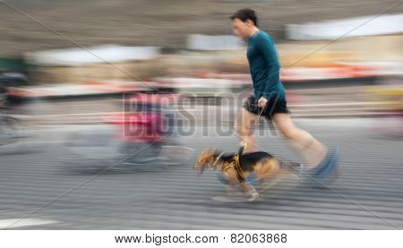 Man Runs With His Dog Outside