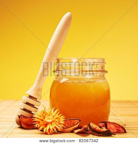 Honey jar, potpourri and wooden dipper