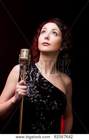 Attractive Young Woman Vocalist With Retro Microphone Musical Performance