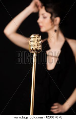 Beautiful Slim Girl Vocalist Behind Golden Vintage Microphone