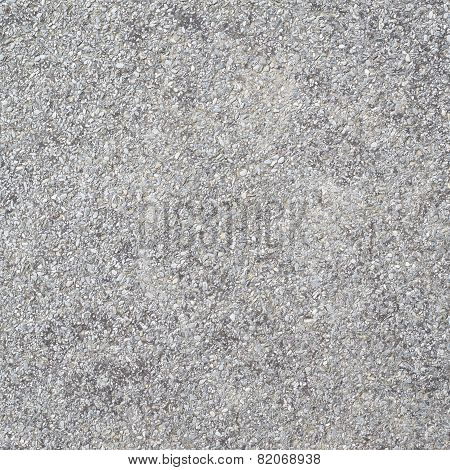 Concrete wall covered with pebbles