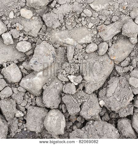 Dried soil covered with stones and dust