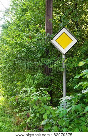 Road Sign In A Bush