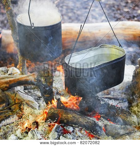 Two Pots Above The Fire.