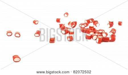 Multiple red candy sweets spilled over the surface