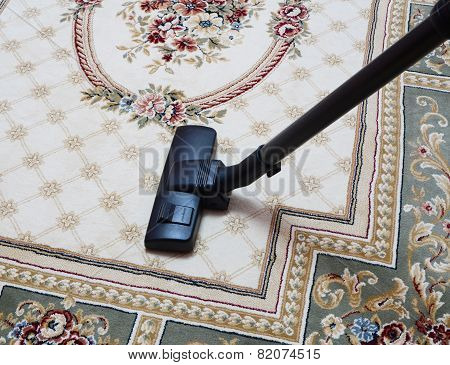 carpet vacuuming with vacuum cleaner