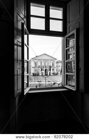 Mortara, Pavia, main square through an open window. Black and white image