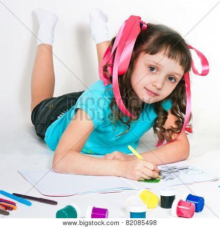 The Girl Draws Lying On A Floor