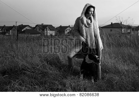 woman standing with staffordshire terrier