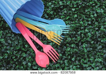 Spoons And Forks Pouring On Turf