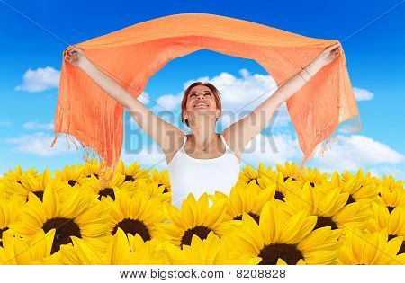 Woman In A Field Of Sunflowers