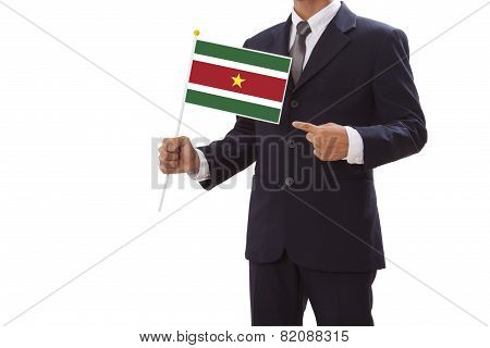 Businessman in suit holding Suriname Flag