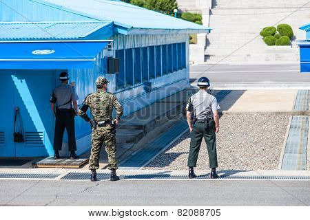 Korean soldiers watching border between South and North Korea in the Joint Security Area (DMZ)