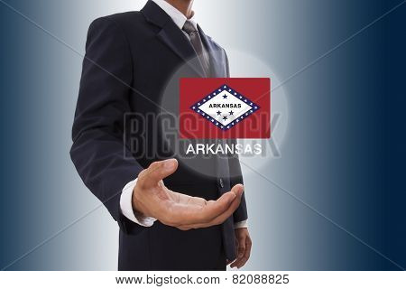 Businessman hand showing Arkansas Flag