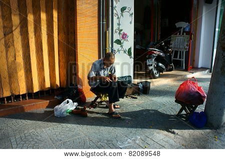 Senior Vietnamese Man, Repair Shoes