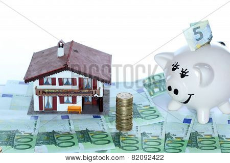 House And Piggybank With Money
