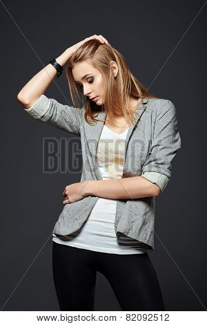 Studio Fashion Shot: Beautiful Young Girl In Leggings, Jacket And Shirt