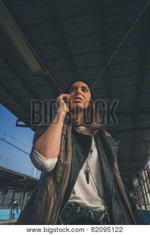 Pretty Girl Talking On Phone In A Metro Station