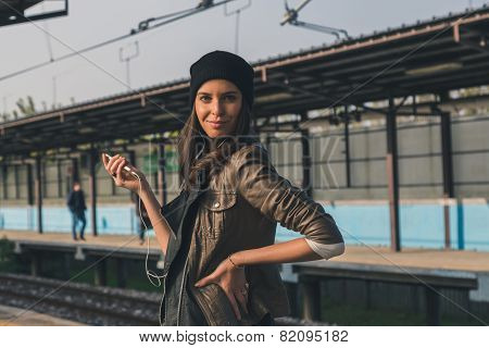 Pretty Girl Listening To Music In A Metro Station