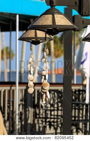 Decorative seashells dangling at a beach