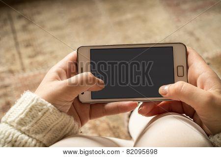 Smartphone In Woman's Hands
