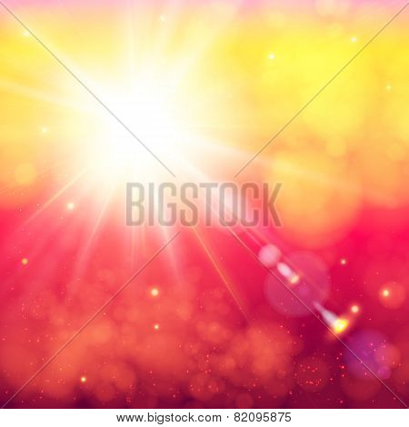 Bright shining sun with lens flare. Soft bokeh background.