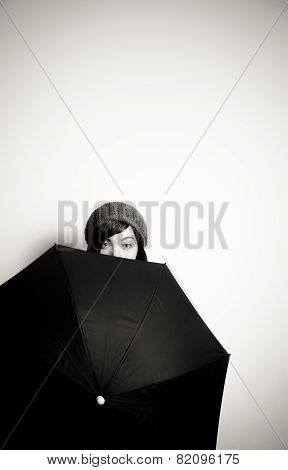 Young Pretty Woman With Hat, Eyes From Behind Black Umbrella