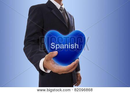 Businessman hand holding blue heart bubble