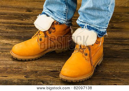 Female Feet In Winter Boots And Jeans