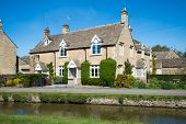 pic of slaughter  - Cottages by a small stream in the quiet Cotswold village of Lower Slaughter - JPG