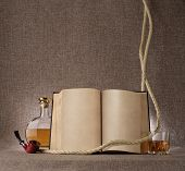 picture of tobacco-pipe  - vintage still life with book whiskey and tobacco pipe on the background fabric texture - JPG