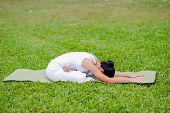 pic of padmasana  - Beautiful woman practicing yoga in the park - JPG