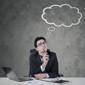 picture of thoughtfulness  - Thoughtful male entrepreneur looking at a cloud tag while imagines his ideas - JPG
