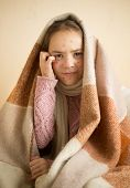 stock photo of itchy  - Portrait of itching little girl with chickenpox - JPG