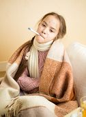 pic of itchy  - Portrait of little girl with chickenpox holding thermometer in mouth - JPG