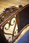 pic of flea  - Detail of an old wooden chair in a flea market - JPG