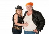 foto of wife-beater  - Woman in leopard skin cowgirl outfit flirting with big bellied man - JPG