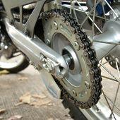 stock photo of dirt-bike  - motorcycle chain and wheel gear of bike - JPG